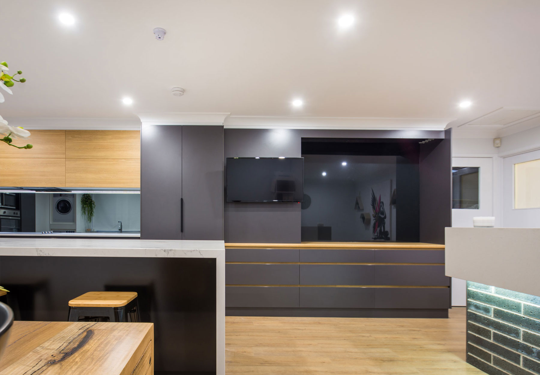 black cabinet and wooden floor style