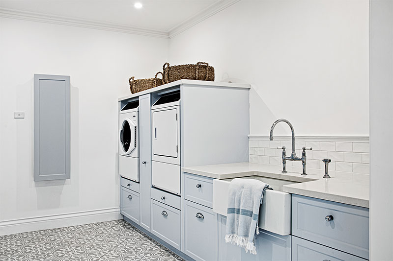 Blue colored laundry cabinet
