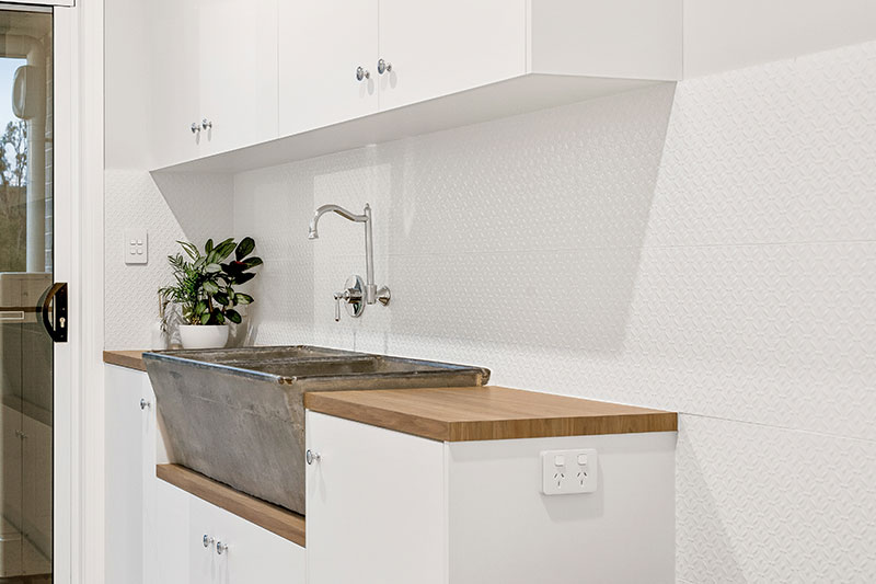 white coloured cabinet and sink