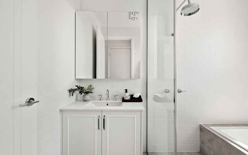 white themed bathroom cabinets