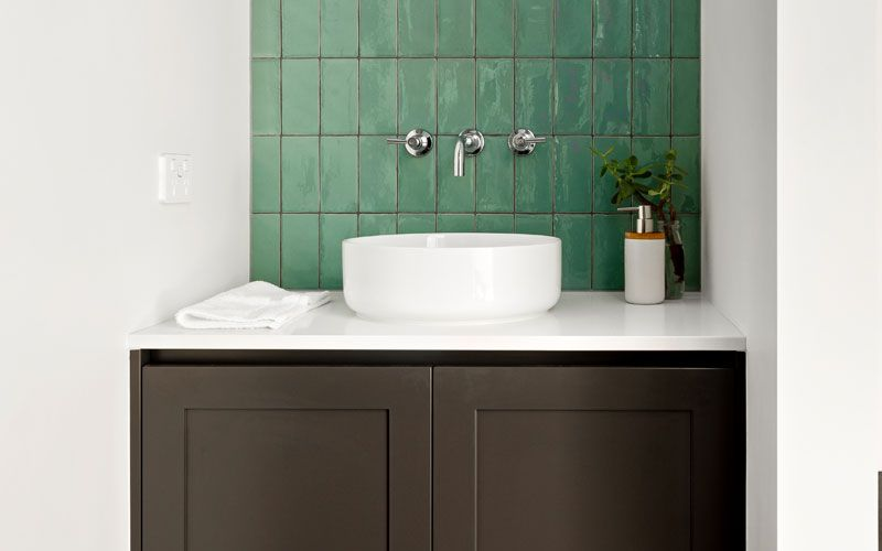 green wall tiled sink