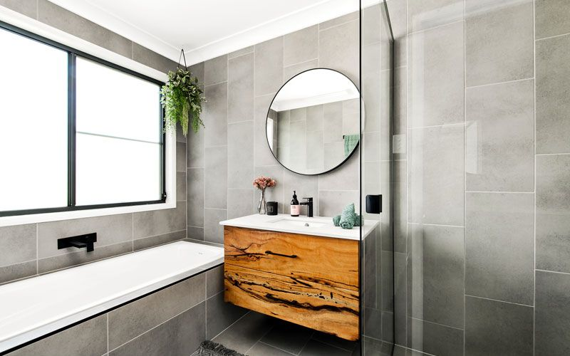gray and wooden themed bathroom