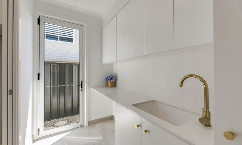 white cabinets with golden faucet sink