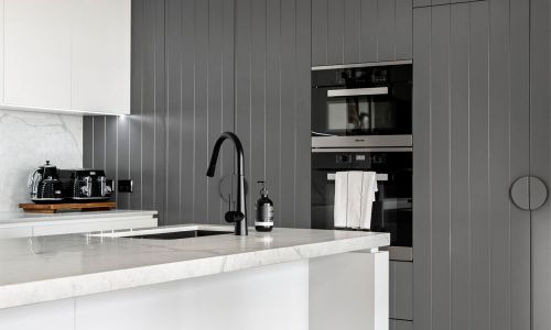 black modern cabinets and sink
