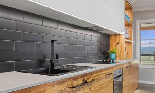 gray bricked wall and kitchen sink
