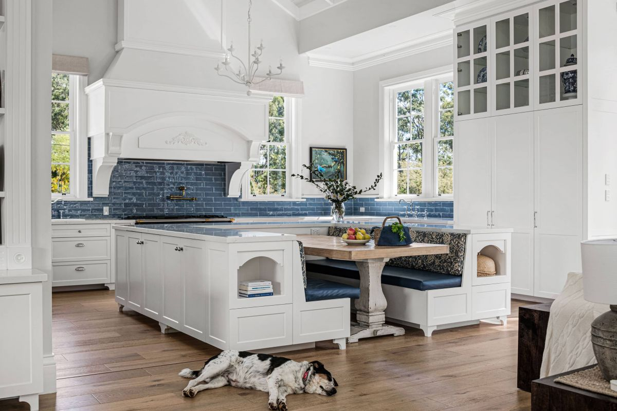 Dog lying on the floor with blue themed kitchen