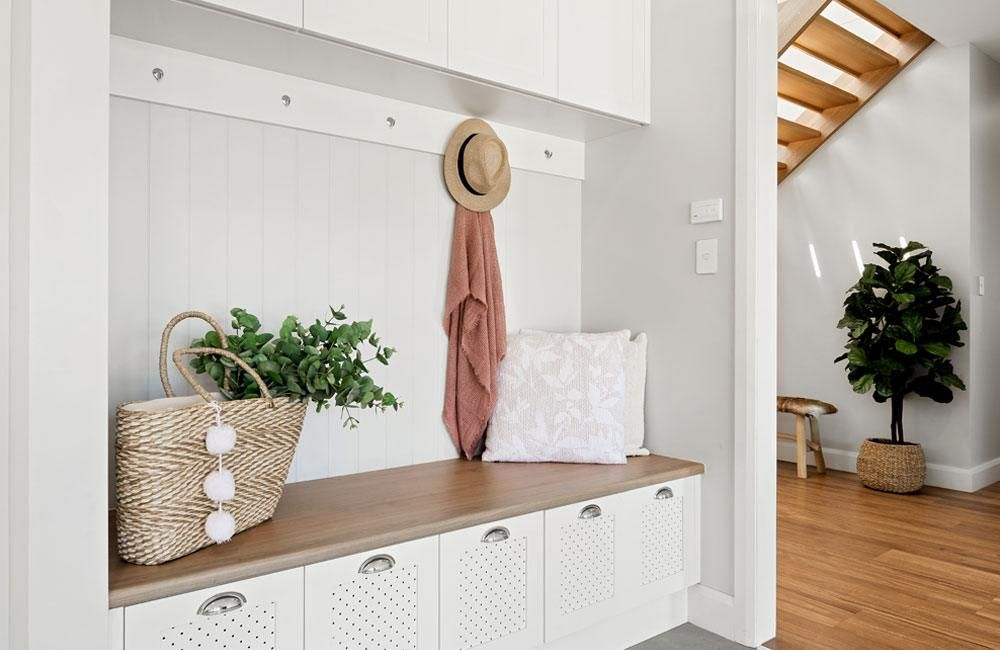 Trafalgar house mudroom in white and wooden seat