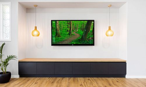 wall tv above wooden modern stationary