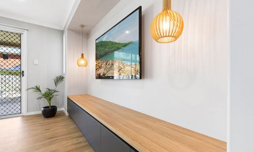 wooden modern stationary with wall tv